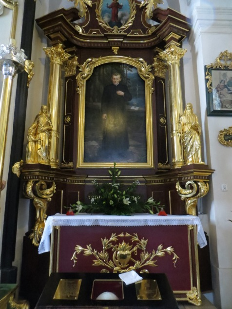 Altar of Blessed Pope John Paul II, Church of Saint Florian, Krakow, Poland.  The white skull cap at the bottom of the photo once belonged to Blessed John Paul, who served as an Associate Pastor at the church from 1949 to 1951.