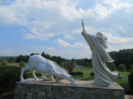 Miracle of the Mule, Shrine of Saint Anthony, Ellicott City, Maryland, USA.  This statue group is located on the grounds of the Shrine of Saint Anthony.  A mule or donkey kneels before the Eucharist, held aloft by Saint Anthony in a monstrance.