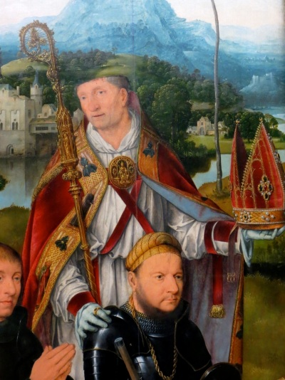 Joos van Cleve, Saints George and Nicasius with donors (detail of Saint Nicasius), oil on panel (c. 1515), Alte Pinakothek, Munich, Germany.  Here, Saint Nicasius is depicted with just the top of his head missing.