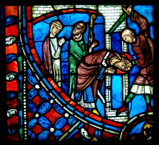 The Martrydrom of Saint Nicasius, stained glass (early 13th century), Basilique Cathédrale Saint-Gervais-et-Saint-Protais de Soissons, Soisson, France.  Courtesy Wikimedia Commons.