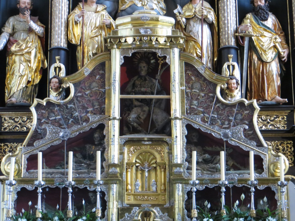 Skeleton of Abbot Konrad II (center) with the Bodies of Four Catacomb Saints, Collegiate Church of Saint Michael, Mondsee, Austria